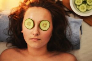 Woman relaxing with moisturiser on her face a few days after having vampire facial UK