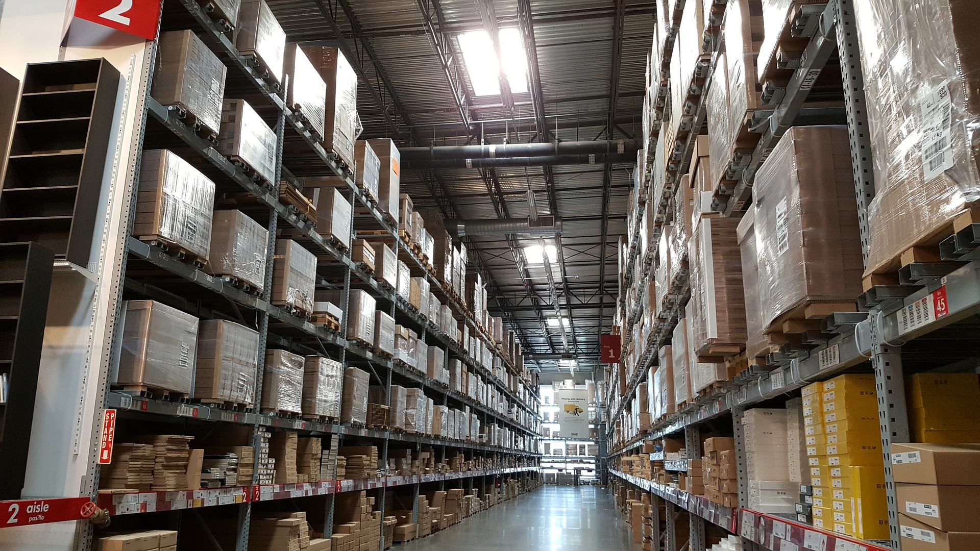 A warehouse which would benefit from a hand forklift due to all of this stock.